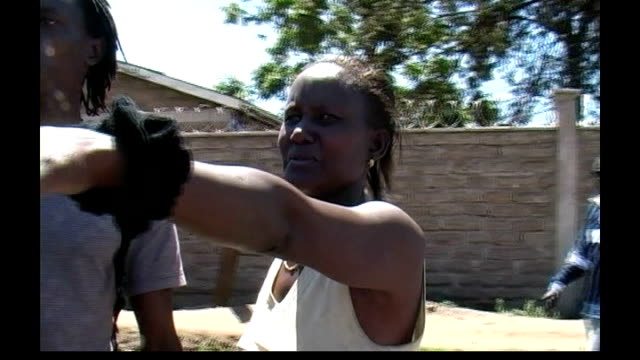 Violence continues in aftermath of elections KENYA Nairobi Matare slum EXT Women wailing with grief next to dead body SOT Woman from Kikuyu tribe...