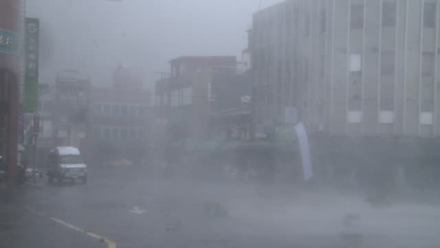 Violent hurricane force winds batter the town of Suao in Taiwan as typhoon Dujuan makes landfall