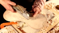 violin craftsman measuring thickness of violin part.Real time.