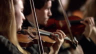 PAN CU R/F Violinists playing in orchestra / London, United Kingdom