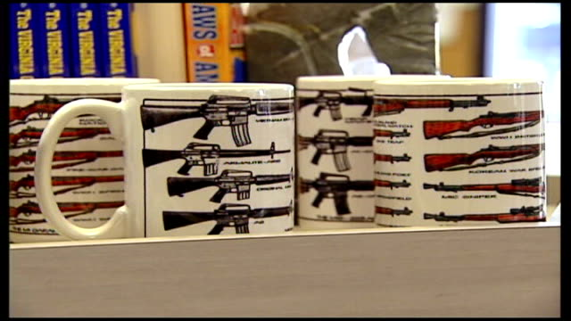 Students return to classes USA Virginia Blacksburg INT Gunshop Blue Ridge Arsenal opening for business Shooting range at back of shop AK47 machine...