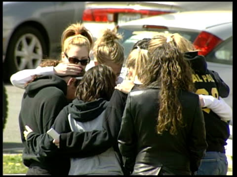 details emerge about gunman Cho SeungHui USA Virginia Centreville Westfield School EXT Female teenagers in group hug Shrines set up to Erin Peterson...