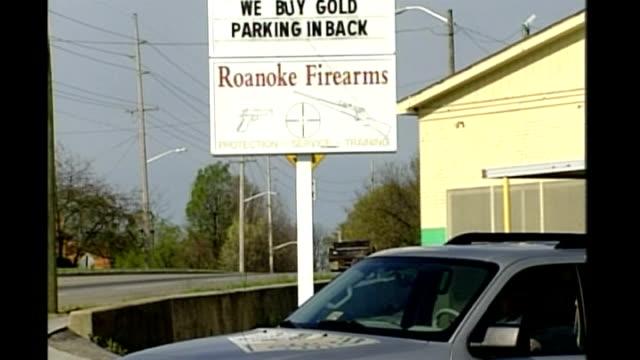 details emerge about gunman Cho SeungHui Blacksburg EXT General views sign for 'Roanoke Firearms' gun shop
