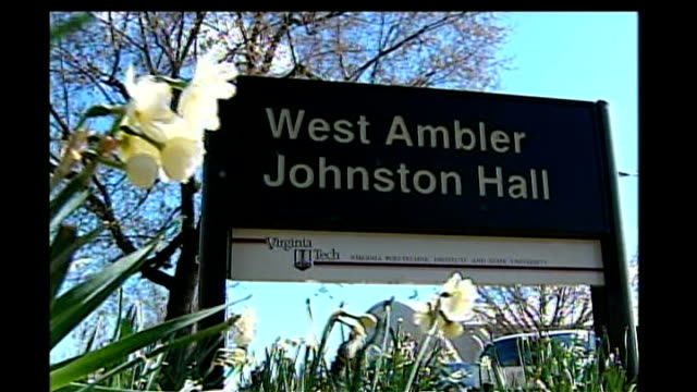 Killer identified/ police name victims Sign for West Ambler Johnston Hall