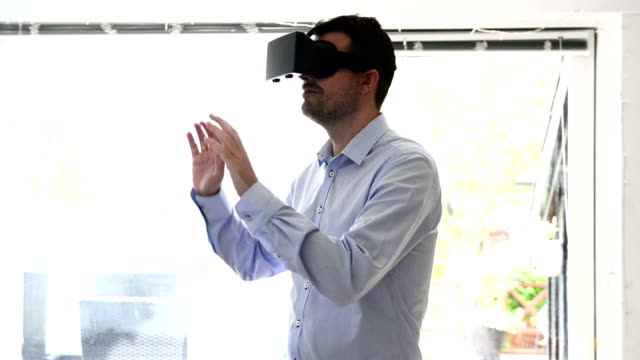Virtual reality headet worn by man