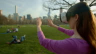 Virtual reality headset googles glasses Central Park NYC woman