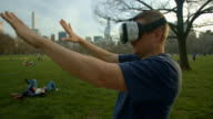 Virtual reality headset googles glasses Man Central Park NYC