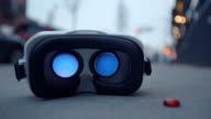 Virtual reality headset googles glasses on sidewalk blinking back
