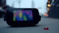 Virtual reality headset googles glasses on sidewalk blinking front