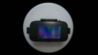 Virtual reality headset googles glasses slowly rotating turning table front