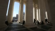 Visitors and tourists pass between marble columns near the Basilica in St Peters Square in Vatican City on Tuesday Feb 17 gvs of St Peters Square