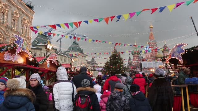Visitors at a Christmas market on Red Square in Moscow Russia on Wednesday Dec 28 Souvenir matryoshka dolls decorated with Donald Trump US President...