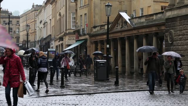 Visitors brave the rain on the streets of Bath on May 20 2015 in Bath England