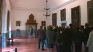 WS PAN Visitors in Audience Chamber portrait gallery, El Escorial palace, Northwest of Madrid, Spain