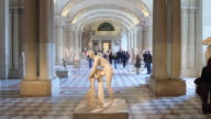 T/L Visitors in the Greek Antiquity Hall at the Louvre / Paris, Ile de France, France