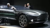 Visitors look at a green Aston Martin Vulcan automobile produced by Aston Martin Lagonda Ltd as it stands on display on the opening day of the 85th...