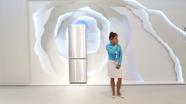 Visitors look at a Samsung RB8000 fridge freezer appliance at the Samsung Electronics Co exhibition stand during previews for the IFA International...
