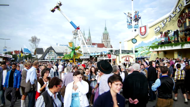 Visitors On Oktoberfest Fairgrounds (4K/UHD to HD)
