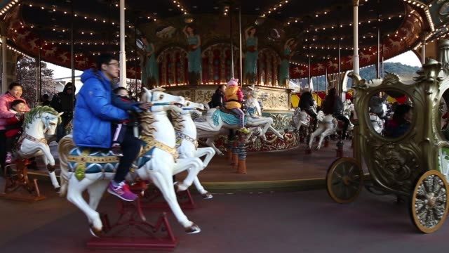 Visitors ride a moving carousel in the Everland Resort operated by Cheil Industries Inc in Yongin Gyeonggi Province South Korea on Friday Nov 14 2014