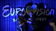Visitors stand in front a logo during the Ukrainian final of the Ukrainian national qualification for the Eurovision Song Contest in Kiev Ukraine 25...