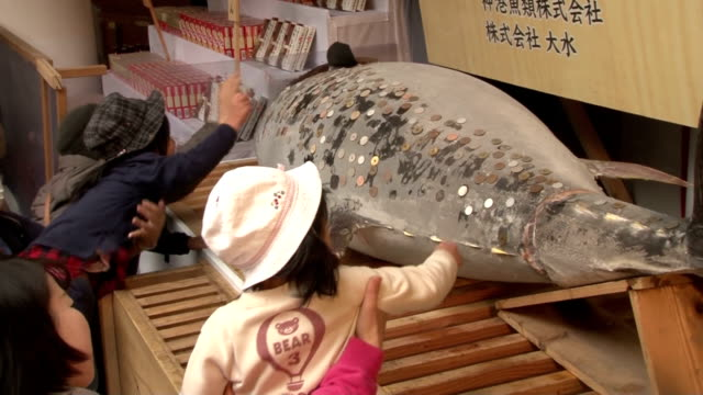 Visitors to Nishinomiya Shrine known as the head shrine of the Ebisu deity of economic fortune in the western Japan city of Nishinomiya attach coins...