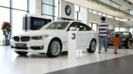 Visitors view Bayerische Motoren Werke AG vehicles on display at the companys driving center BMW motorcycles on display at the companys driving...