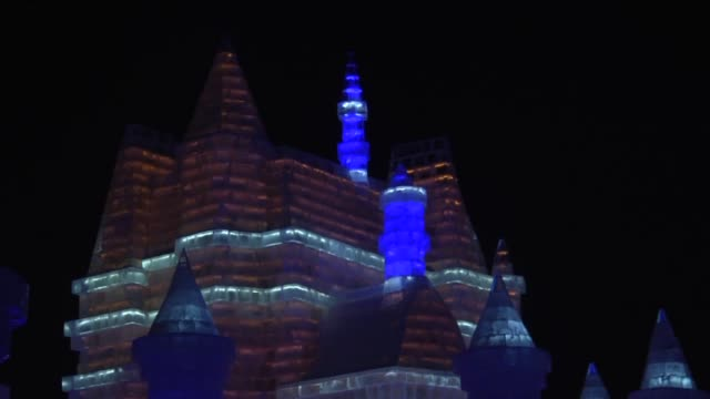 Visitors visit illuminated ice sculptures during the 32nd Harbin Ice and Snow Sculpture Festival in Harbin China on January 26 2016 The main...