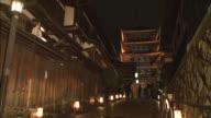Visitors walk near a five-story pagoda on a street lined with glowing lanterns during the Hanatoro festival in Higashiyama-ku, Kyoto, Japan.