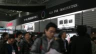 Visitors walk past the Canon Inc booth in exhibition hall Canon at the CP Camera and Photo Imaging Show Pa on January 31 2013 in Yokohama City Japan