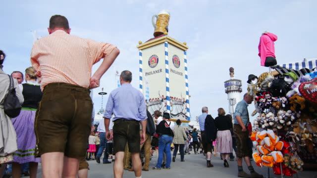 Visitors Walking Through Oktoberfest Fairgrounds (4K/UHD to HD).
