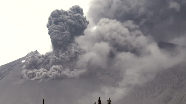 Volcanic ash erupts vigorously from the crater at Sakurajima volcano in Japan