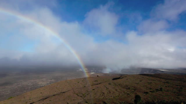 WS T/L Volcanic smoke drifts to Kilauea caldera rainbow and appears over Kilauea caldera / Halemaumau Crater, Hawaii, USA