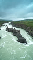 Volcano Rocks in Godafoss river vertical