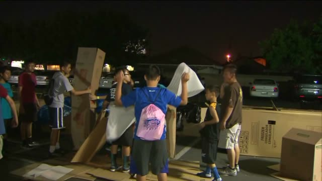 Volunteers camped outside in boxes overnight in support of homeless families in their area on October 01 2012 in San Gabriel California