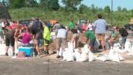 WGN Volunteers Filling Sandbags After Major Flooding in Algonquin Illinois on July 16 2017