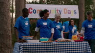 Volunteers gather for community picnic