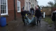 Volunteers help the residents of Tadcaster clear up as water levels decline after flooding over the Christmas period on December 28 2015 in Tadcaster...