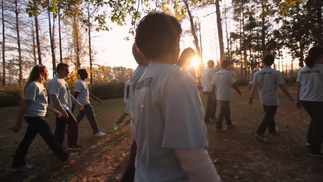 Volunteers pass camera in charity walk