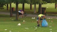 Volunteers pick up litter at the park near Montrose Beach on July 14 2014 in Chicago Illinois