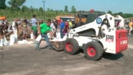 WGN Volunteers Pile Up Sandbags in Bulldozers After Major Flooding in Algonquin Illinois on July 16 2017