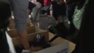 Volunteers sorting items into boxes for victims of the Grenfell Tower fire
