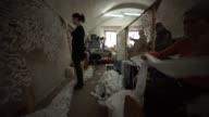 Volunteers work on camouflage nets in abandoned fortress Tower No 4 in Kiev Ukraine on Thursday January 15 gvs of the volunteers working gv of the...