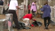 KTVI Volunteers Work to CleanUp a Historic Jewish Cemetery Chesed Shel Emeth Cemetery in St louis on Feb 22 2107 after vandals knocked over and...