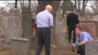 KTVI Volunteers Worked to CleanUp a Historic Jewish Cemetery Chesed Shel Emeth Cemetery in St louis on Feb 22 2107 after vandals knocked over and...