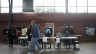 Voters enter and exit a polling place at a South Carolina National Guard armory on the morning of the South Carolina Republican presidential primary...
