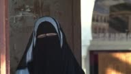Voters in Switzerlands Italian speaking region Sunday slapped a ban on wearing full face veils a move condemned by the countrys Muslim community and...