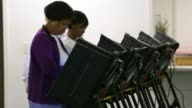 Voters use the voting machines to cast their ballots on Election Day Greensboro NC November 4 2014