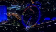 Votes counted across the country after a day of people going to the polls Shows exterior aerial night shots the London Eye lit up in party colours...