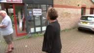 Voting Sadiq Khan at polling station ENGLAND London Streatham EXT Sadiq Khan and wife Saadiya Khan arriving at polling station greet election workers...