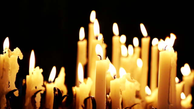 Votive candles burning in a church